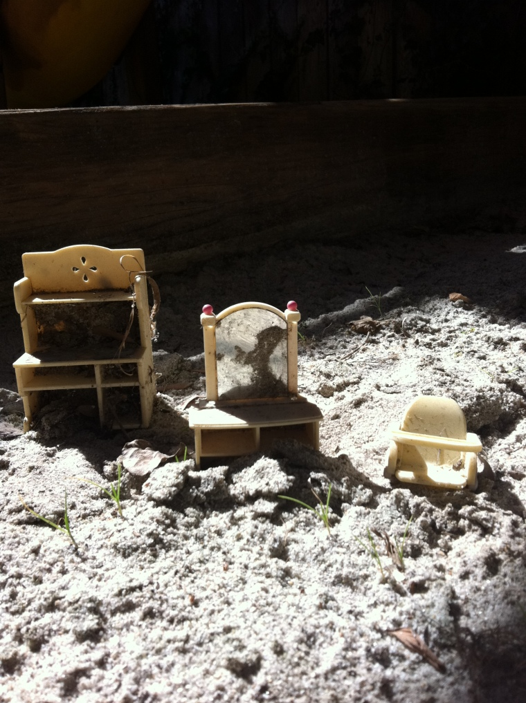 Tiny furniture left behind in our sand box.